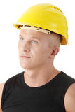 Young handsome builder in yellow helmet. Stock Photos