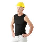 Young handsome builder in yellow helmet. Royalty Free Stock Photo