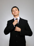 Young handsome business man in black suit Stock Photo