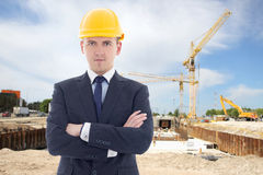 Young handsome business man in builder's helmet Royalty Free Stock Photography