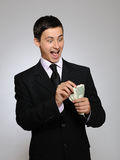 Young handsome business man counting money Royalty Free Stock Photos
