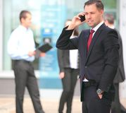 A young handsome business man on phone Stock Photo