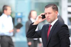 A young handsome business man on phone Stock Images