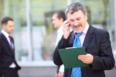 A young handsome business man on phone Royalty Free Stock Photos