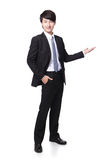Young handsome Business man presenting Stock Image
