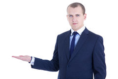 Young handsome business man presenting a copyspace isolated on w Stock Photography