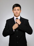 Young handsome business man in suit with the tie Stock Images
