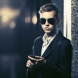 Young handsome business man using smart phone in a night city street Royalty Free Stock Photo