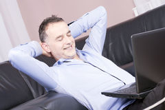 Young handsome business man working from home. royalty free stock photography
