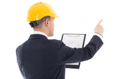 Young handsome business man in yellow builder's helmet with blue Stock Images
