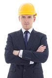 Young handsome business man in yellow builder's helmet isolated Stock Photo