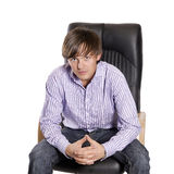 Young, handsome businessman. Young, handsome man sitting on a chair Royalty Free Stock Photography
