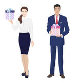 Young handsome businessman and beautiful busineswomen secretary with present gift box. Royalty Free Stock Photography