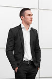 Young handsome businessman in black suit. Beautiful modern man Royalty Free Stock Photography