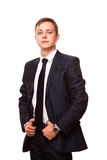 Young handsome businessman in black suit is standing straight, full length portrait isolated on white background Royalty Free Stock Photography