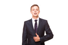 Young handsome businessman in black suit is standing straight, portrait isolated on white background Royalty Free Stock Photography