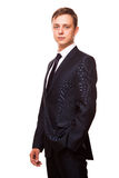 Young handsome businessman in black suit is standing straight, portrait isolated on white background Stock Image