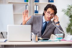 The young handsome businessman in budget planning concept stock photography