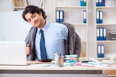 The young handsome businessman in budget planning concept stock images