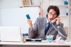 The young handsome businessman in budget planning concept royalty free stock photos