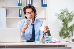 The young handsome businessman in budget planning concept. Young handsome businessman in budget planning concept stock image