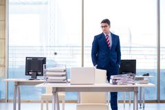 The young handsome businessman employee working in office at desk Royalty Free Stock Photography