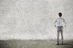 Young handsome businessman on grunge background Royalty Free Stock Photography