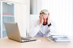 Young Handsome Businessman Has Headache. Young Sleepy Business Man Sitting At Workplace - In office Stock Photos