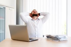 Young Handsome Businessman Has Headache. Young Sleepy Business Man Sitting At Workplace - In office Royalty Free Stock Images