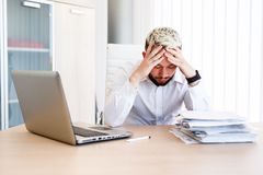 Young Handsome Businessman Has Headache. Young Sleepy Business Man Sitting At Workplace - In office Stock Images