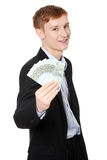 Young handsome businessman holding euros Stock Photo