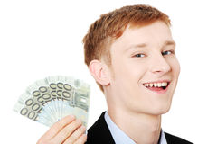 Young handsome businessman holding euros Stock Photos