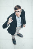 Young handsome businessman making ok sign . Top view. Stock Image