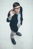 Young handsome businessman making ok sign . Top view. Royalty Free Stock Images