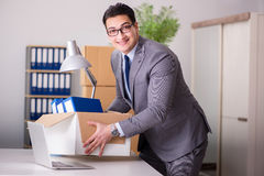 The young handsome businessman moving offices Royalty Free Stock Photos
