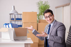 The young handsome businessman moving offices Royalty Free Stock Image