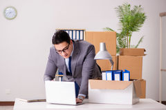 The young handsome businessman moving offices Stock Images