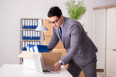 The young handsome businessman moving offices Stock Photos