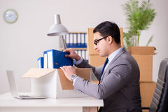 The young handsome businessman moving offices Royalty Free Stock Photography