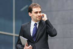 A young and handsome businessman on the phone Stock Photography