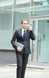 A young and handsome businessman on the phone Royalty Free Stock Photography