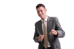 Young, handsome businessman pointing forward royalty free stock image