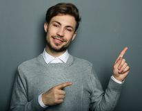 A young and handsome businessman pointing up with his finger royalty free stock photos