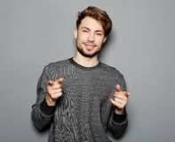 A young and handsome businessman pointing up with his finger Royalty Free Stock Photo