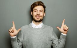 A young and handsome businessman pointing up with his finger royalty free stock images