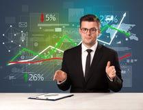 Businessman sitting at a desk Stock Photos