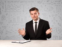 Businessman sitting at a desk Royalty Free Stock Photography