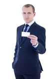 Young handsome businessman in suit holding business card isolate Stock Images