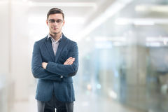 Young handsome businessman wearing glasses in the Royalty Free Stock Images