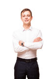 Young handsome businessman in white shirt is standing straight and crossing his hands, portrait isolated on white Royalty Free Stock Photos